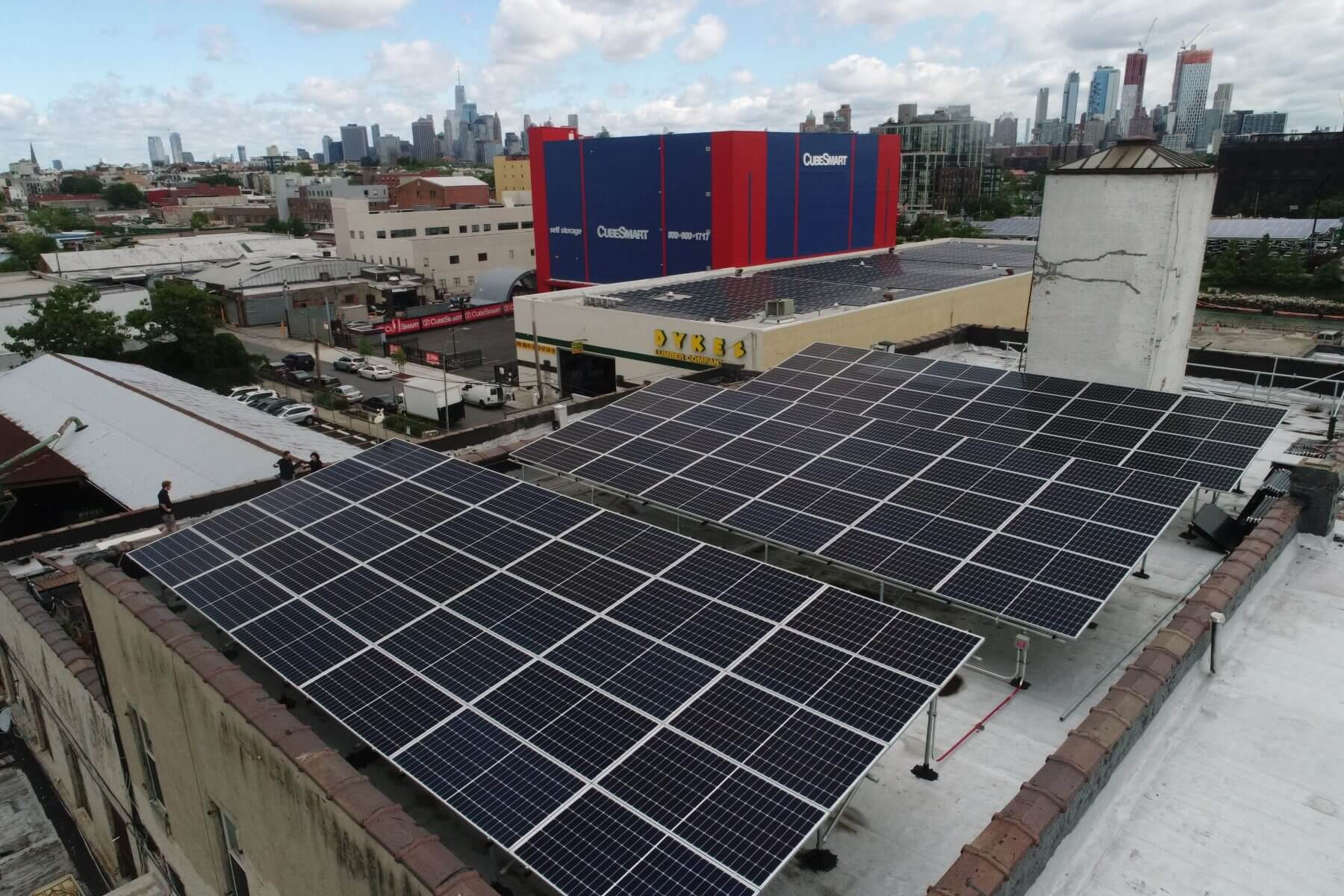 A 32 KW Tilt Rack installation on BSW's Gowanus headquarters. The electricity generated by the system is credited directly to BSW team member's monthly ConEd bills using community solar.