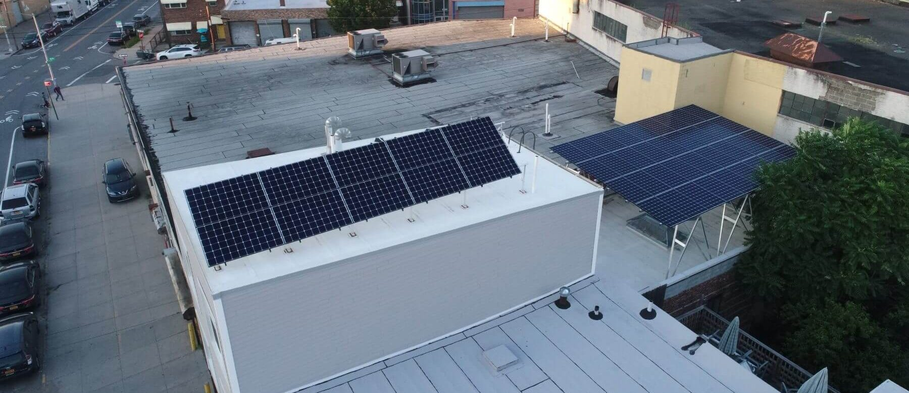 A hybrid tilt and canopy solar system installed on Workforce Housing Group's headquarters in Long Island City.