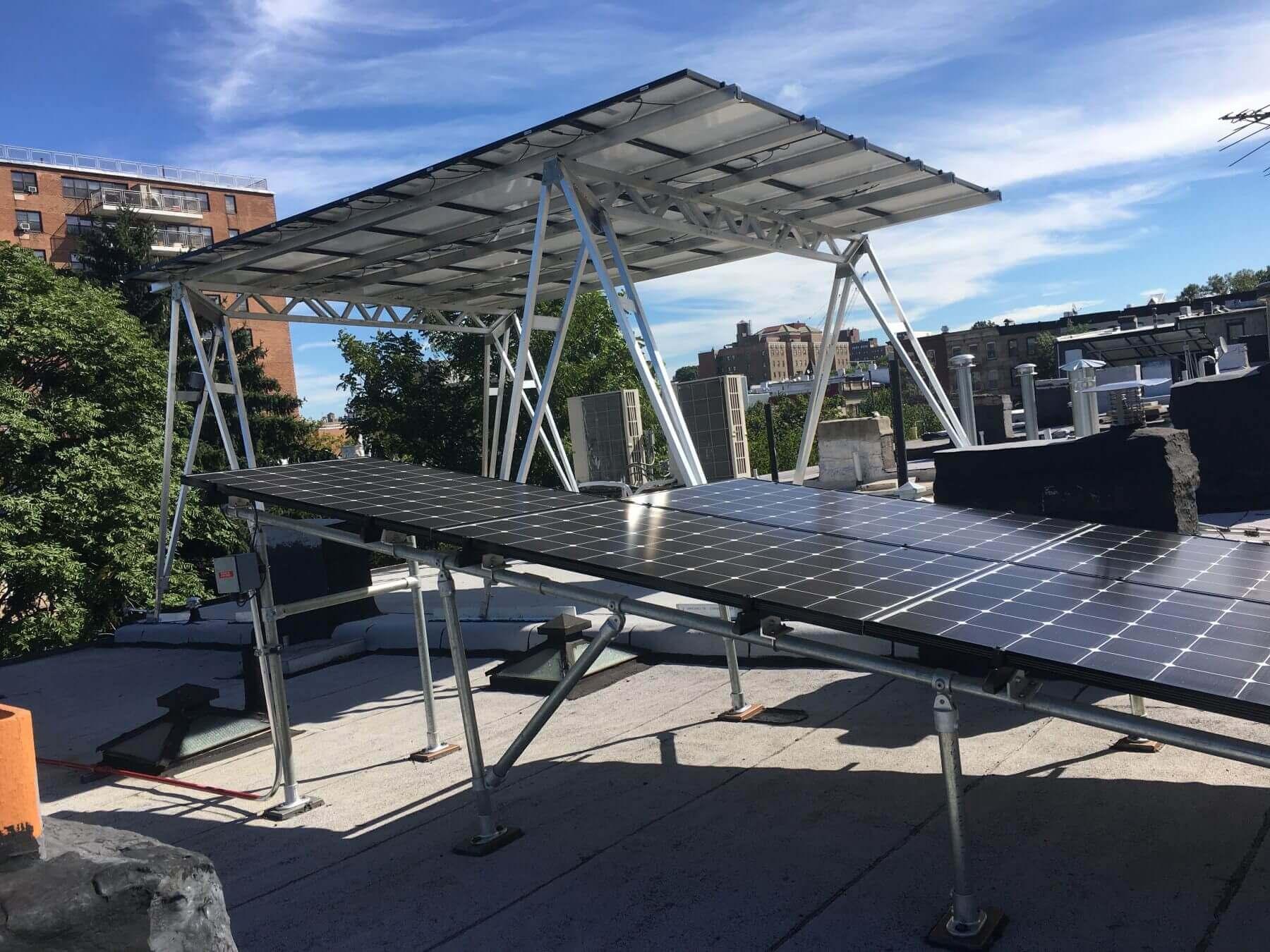 solar company and tilt rack on flat roof