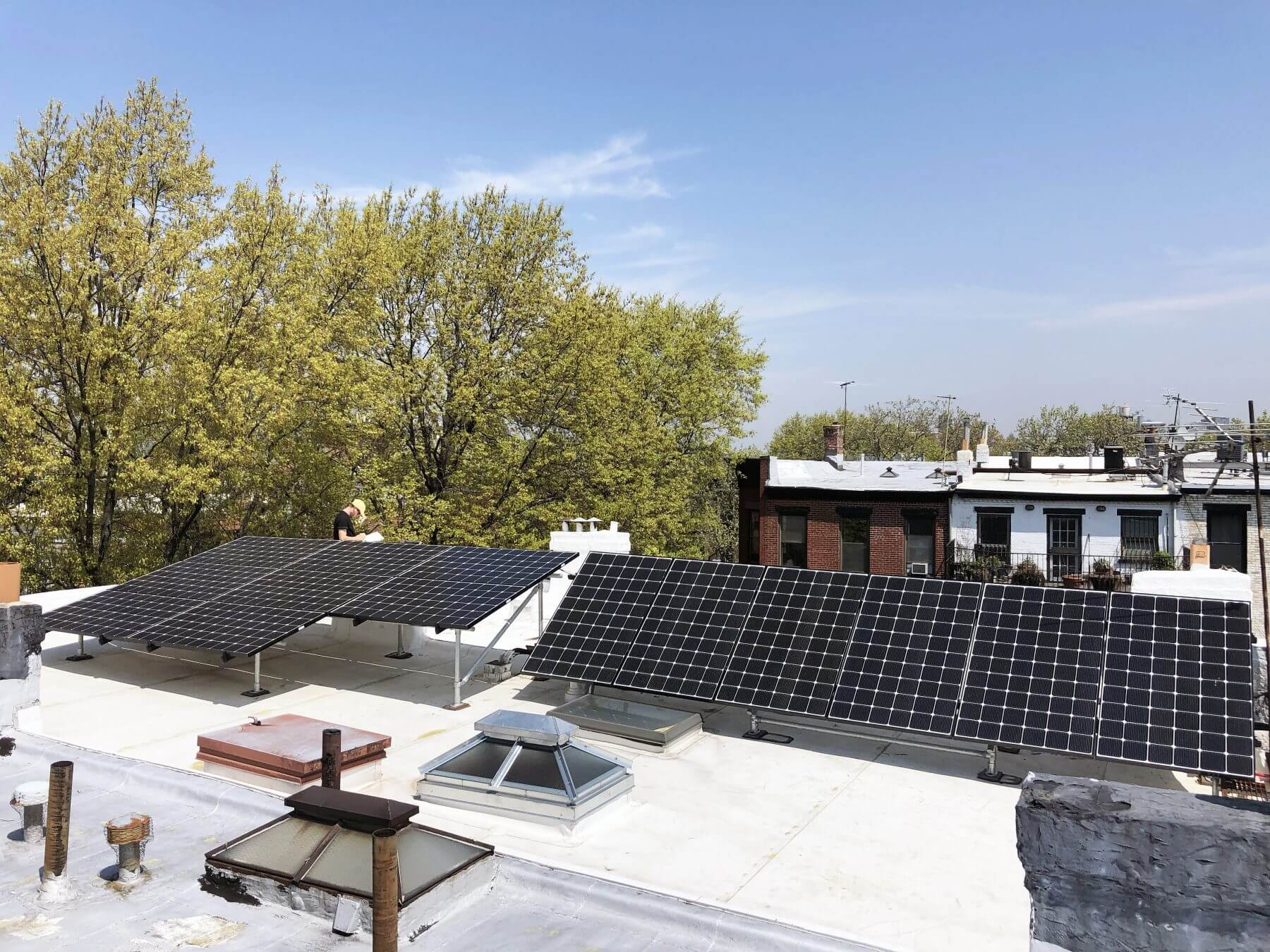 Solar modules pitched and positioned to work around hatches and skylights.