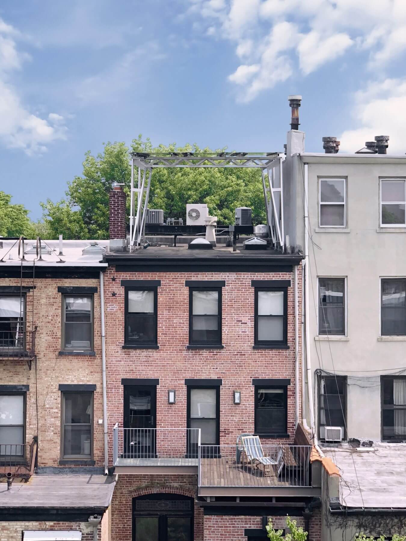 Shade from a neighbor, HVAC equipment and lots of dunnage. Solar could not happen on this Lefferts Gardens roof without a Brooklyn Solar Canopy.