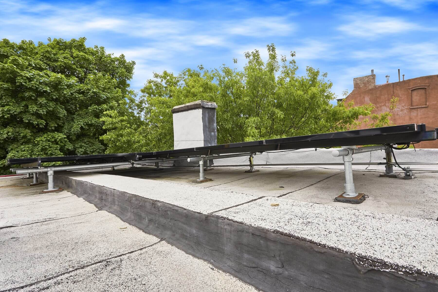 Solar arrays pitched at 2 degrees to avoid visibility from the street.